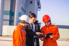 Boss or Chief  instructs young team of  young engineers on table Stock Photos