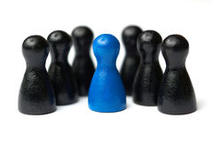 Boss, chief or team leader standing in the middle of his team. Business concept for leadership, teamwork or groups Stock Image