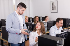 Boss and clerk at open space working area Royalty Free Stock Images