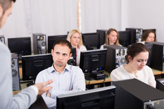 Boss and clerk at open space working area. Strict boss and unhappy clerk at open space working area stock photos