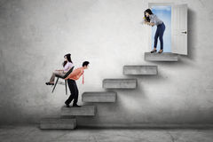 Boss commanding her employees on stair Royalty Free Stock Photo
