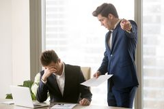 Dissatisfied annoyed boss arguing with employee Royalty Free Stock Photos