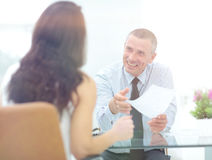Boss discusses with the assistant business documents in the offi Stock Images
