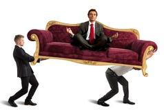 Boss doing yoga on sofa Royalty Free Stock Photography