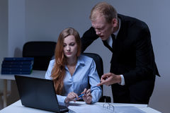 Boss and employee. Angry boss and his confused employee in the office Stock Images