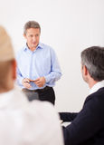 Boss with employees Royalty Free Stock Photography