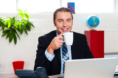 Boss enjoying hot coffee during work break Stock Images