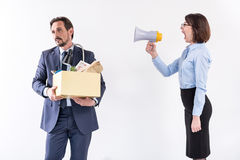 Boss female is yelling at her worker Stock Images
