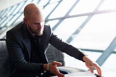 The boss focused in the job which some important  documents Royalty Free Stock Photography