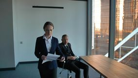 Boss giving difficult task to confident lady employee. Challange to not be layed out stock footage