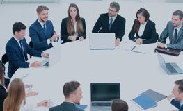 Boss gathered his team for a round table to discuss a new projec Stock Photography
