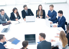 Boss gathered his team for a round table to discuss a new projec Stock Image