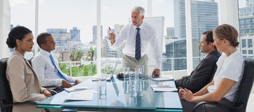 Boss gesturing in front of colleagues Royalty Free Stock Images