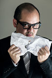 Boss getting angry and tear off paper. With gray background Royalty Free Stock Photos