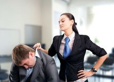 Boss. Girl pulls a men by the collar suit Stock Images