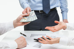 Boss giving dollars to collaborators Royalty Free Stock Images