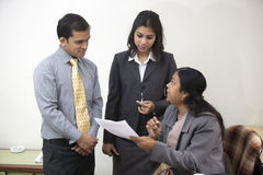 Boss giving Instructions to Subordinates at her of Stock Image