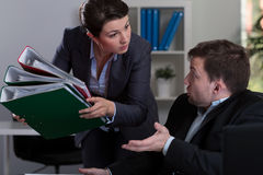 Boss giving more job Stock Images
