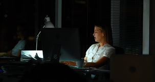 Boss giving new work to businesswoman at night stock footage