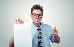 Boss in glasses holding a paper. You signed a contract concept. Stock Photo
