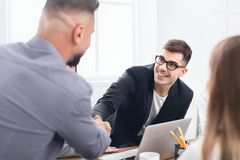Boss congratulating on promotion male subordinate at meeting royalty free stock photos