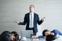 Boss happy and business team sleeping and boring meeting in the. Meeting room at modern office, Business Concept Royalty Free Stock Photo