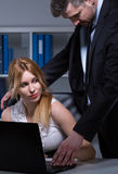 Boss harassing secretary Royalty Free Stock Photo
