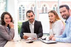 Boss heading a business reunion with partners Royalty Free Stock Images