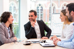Boss heading a business reunion with partners Stock Photo