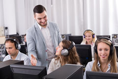 Boss and his call center team at office. Happy boss and his call center team at office stock photography