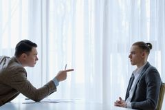 Boss employee giving lecture reprimand business. Boss his employee a lecture. verbal reprimand and scolding for some work failure. cruel business world concept stock images