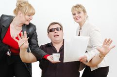 Boss and his secretaries Royalty Free Stock Photography