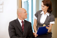Boss and his secretary looking on documents Stock Photo