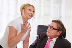 Boss and his secretary speaking in office. Woman has idea Stock Images