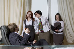 Boss with his women colleagues. Royalty Free Stock Photos