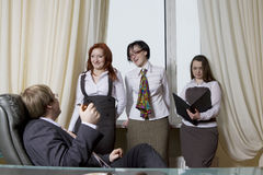 Boss with his women colleagues Stock Photos
