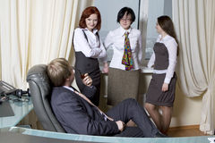 Boss with his women colleagues. Royalty Free Stock Image