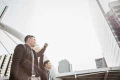 Boss hold his employee or businessman hand and raise his arm to stock photo