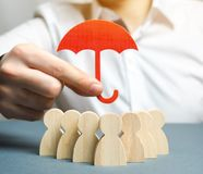 Free Boss Holding A Red Umbrella And Defending His Team With A Gesture Of Protection. Security And Safety In A Business Team. Life Stock Photography - 140723192