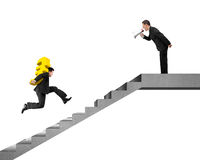 Boss holding yelling at employee carrying Euro running on stairs Royalty Free Stock Images