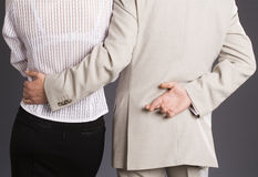 Boss hugs his subordinate Stock Image