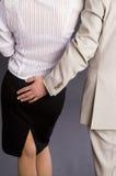 Boss hugs his subordinate Stock Photography