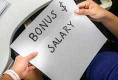 Boss inform new salary and annual bonus to the employee. Close up boss inform new salary and annual bonus to the employee stock image