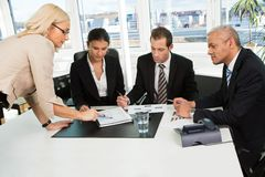 Boss instructing business team Royalty Free Stock Images