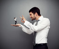 Boss kicking out of the employer. Concept photo of wicked boss kicking out of the employer stock photography