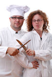 Boss of kitchen and cook crucifying knives Royalty Free Stock Images
