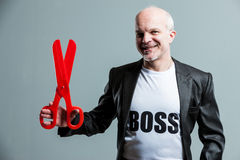 Boss with large scissors Royalty Free Stock Photography