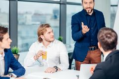 Boss leader coaching in office. On job training. Business and Education concept. Bearded boss leader coaching and teaching in modern office. On job training Royalty Free Stock Image