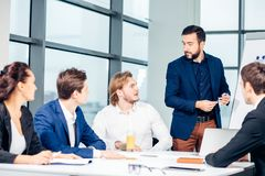 Boss leader coaching in office. On job training. Business and Education concept. Bearded boss leader coaching and teaching in modern office. On job training Royalty Free Stock Photography