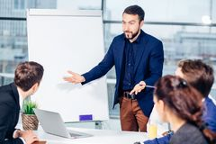 Boss leader coaching in office. On job training. Business and Education concept. Bearded boss leader coaching and teaching in modern office. On job training Stock Images